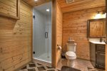 Basement Bathroom with a shower stall